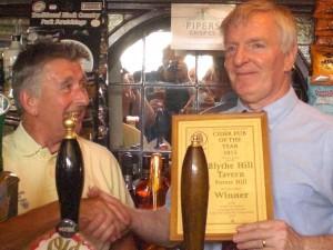 Branch Cider Rep Mike Allen presents the cider award to landlord Con O'Riordan