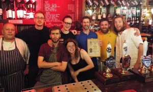 Branch Chair Steve Silcock presents the award surrounded by the pub staff